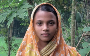 "Child's View – Rina Begum, 14, stands outside her parents' home, in the northern district of Jamalpur in Dhaka Division. Rima, whose education was cut short at Grade 6, was taken out of school to marry. Her husband beats her and has sent her back to her parents. He hopes to secure additional dowry. The photograph was taken by Humayra Yasmin Seba, 14. She is 1 of 30 adolescents who participated in a UNICEF-organized photography workshop.  In September 2009 in Bangladesh, UNICEF supported a photography workshop for 30 adolescents who live in remote rural communities in the districts of Jamalpur, Chapainawabgonj and Barguna. The goal of the workshop was to support adolescents' right to expression, in accordance with articles 12-14 of the Convention on the Rights of the Child (CRC) – and is part of commemorations of the 20th anniversary of the CRC (adopted 20 November 2009). As stated in article 13, the right to expression includes, the child's ""…freedom to seek, receive and impart information and ideas of all kinds … either orally, in writing or in print, in the form of art, or through any other media…."" Workshop participants, aged 14-18, received training in their communities, selected their own themes and were given cameras to take photographs for a week. Themes included documentation of their environments, child labour practices, effects of early marriage and the importance of education, health and sanitation. The imagery they created has been shown in Dhaka, the capital, and is touring the photographers' communities in an exhibition entitled 'Do you see my world?' The workshop was a joint initiative of the Government and UNICEF with Patshala, the South Asian Institute of Photography. It is, in turn, part of a government and UNICEF programme funded by the European Commission – the Adolescents Empowerment Project (in Bengali, 'Kishori Abihijan') – that seeks to promote positive behaviour and social change for the country's 28 m"